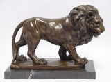 A BRONZE SCULPTURE OF A KING OF ANIMALS