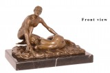 AN EROTIC BRONZE SCULPTURE OF A COUPLE