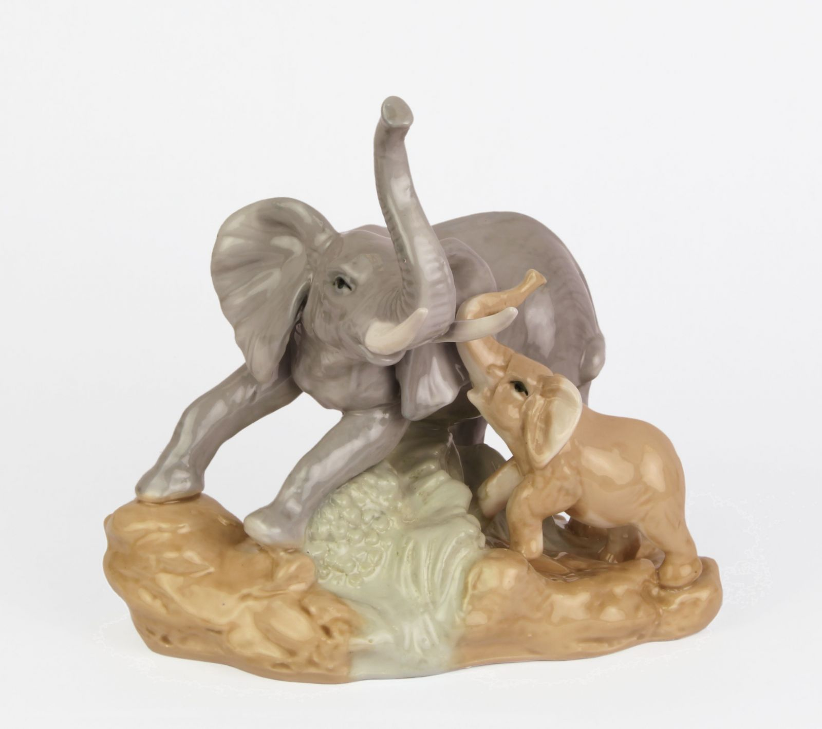 a Statue of an elephant with a child made of porcelain BrokInCZ