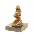 A BRONZE SCULPTURE OF A MOTHER AND CHILD