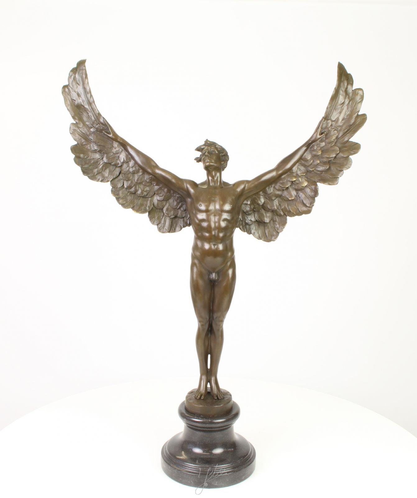 a bronze statue of an angel BrokInCZ