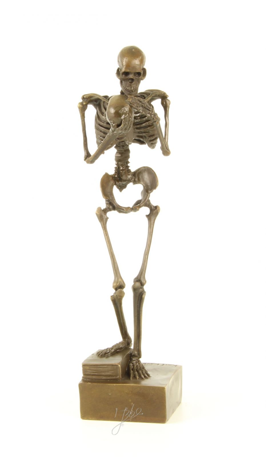 A bronze statue of a skeleton