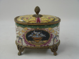 a Porcelain casket with bronze decoration