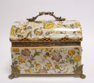 a Porcelain casket with flowers