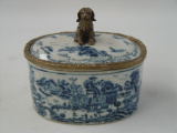a Porcelain casket with bronze dog