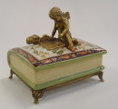 a Porcelain casket - Angel sitting on the book