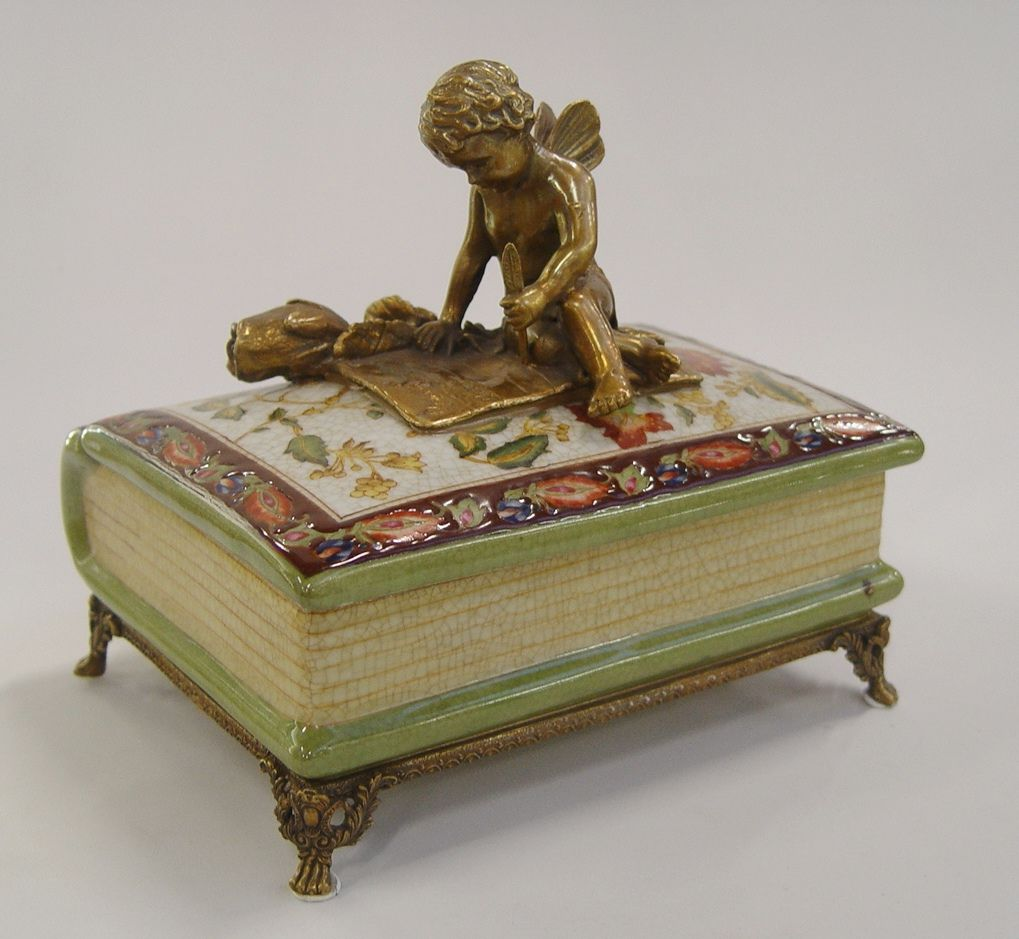 a casket made of porcelain, Angel sitting on the book