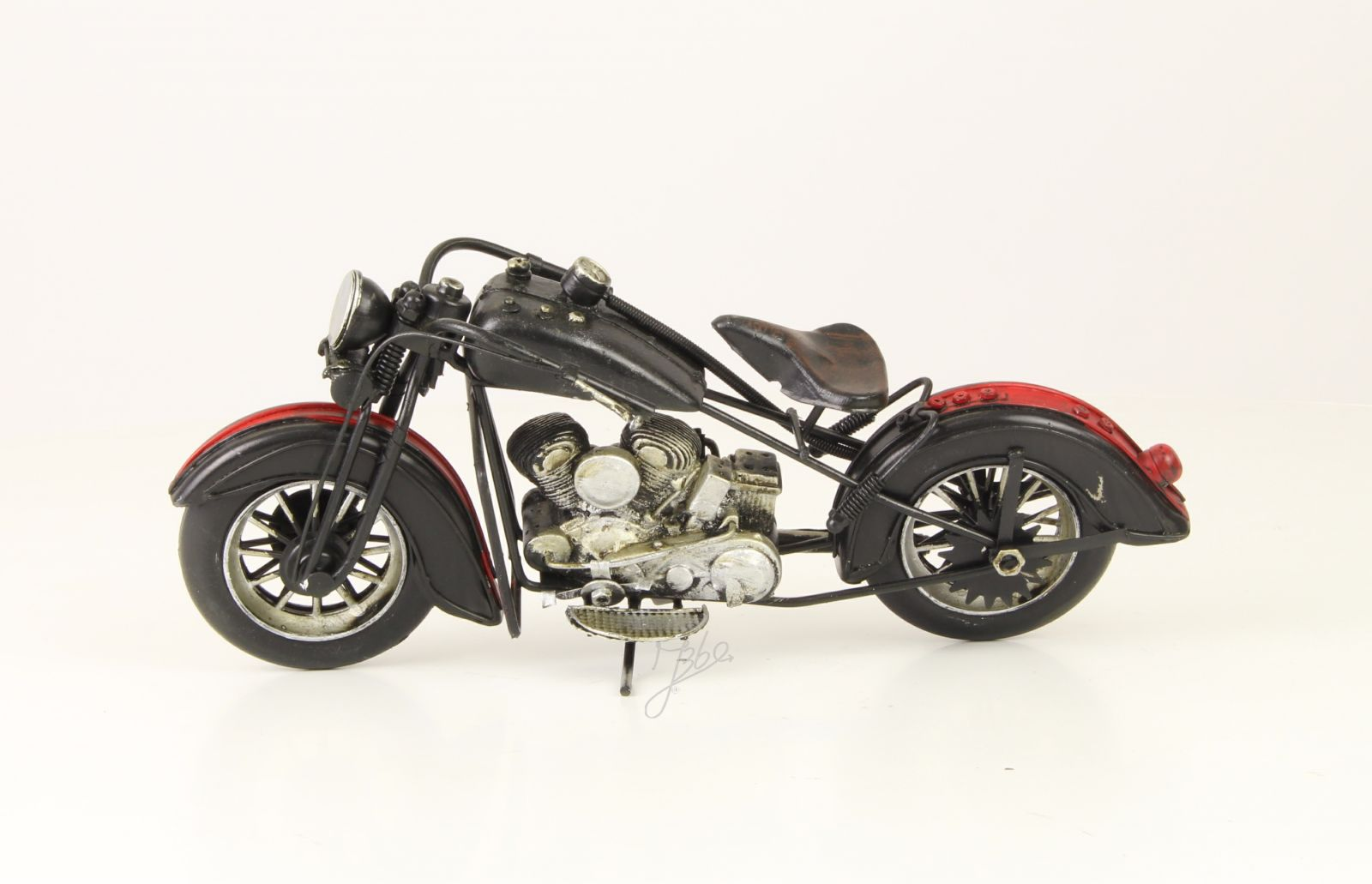A TIN MODEL OF A MOTORCYCLE 1