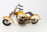 Metal model of a yellow motorcycle