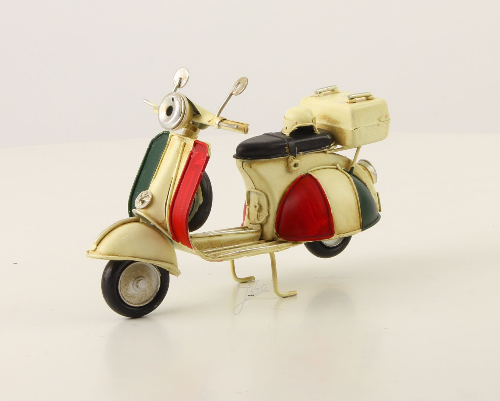 A TIN MODEL OF A SCOOTER