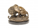 A BRONZE SCULPTURE OF A LION AND SERPENT