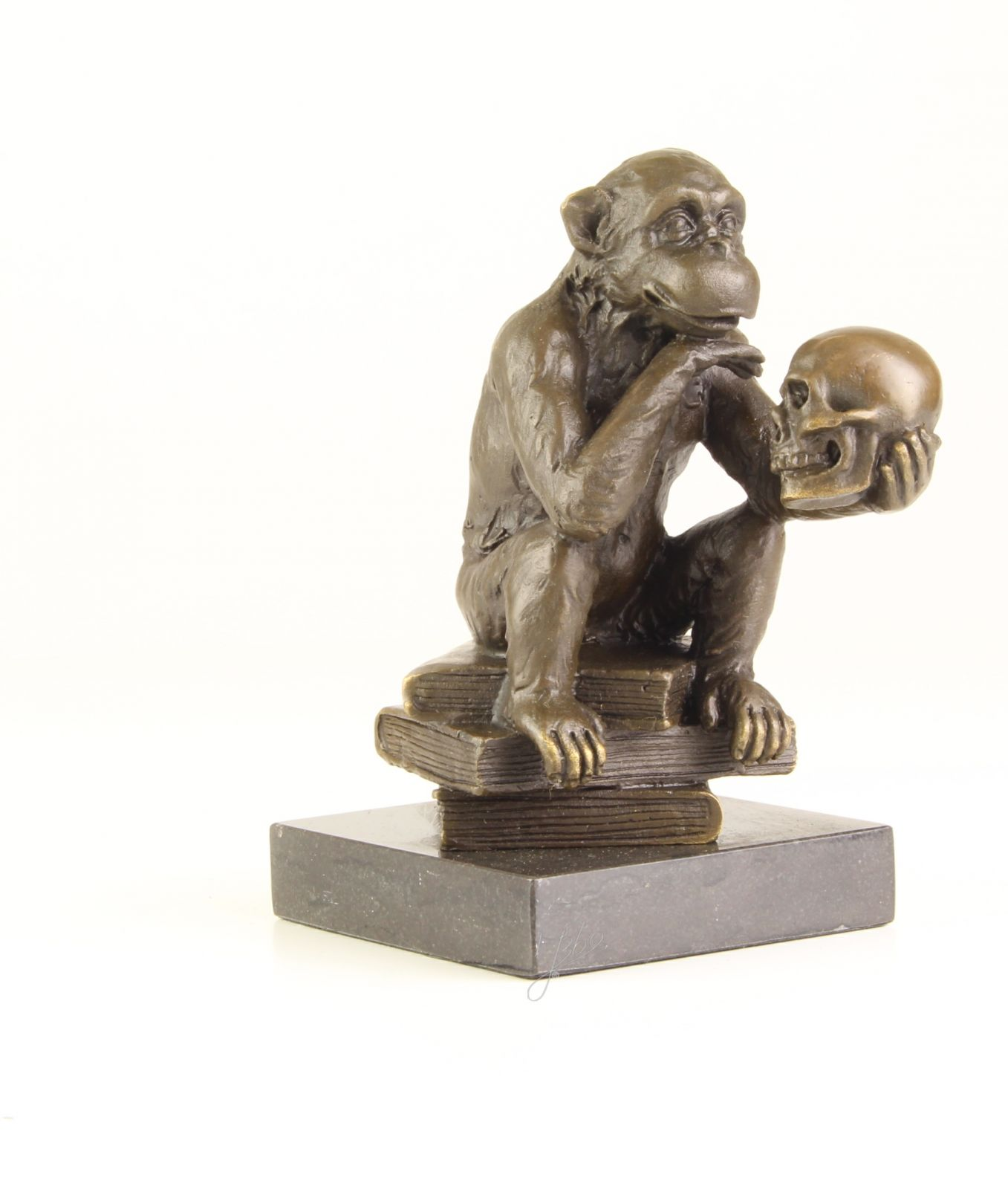 A BRONZE SCULPTURE OF THE APE WITH SKULL BrokInCZ