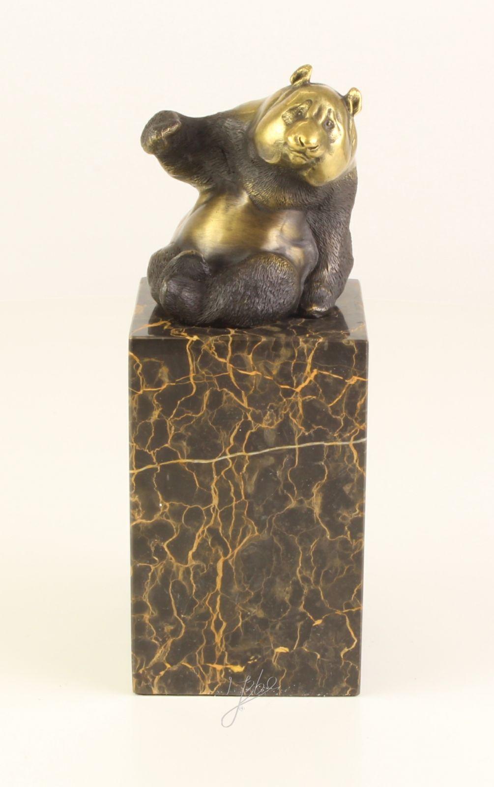 A BRONZE SCULPTURE OF A PANDA BrokInCZ