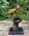 Bronze statue of a naked woman on the wrist