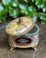 A casket made of porcelain and bronze BrokInCZ