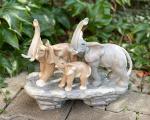 a Statue of an elephant family made of porcelain BrokInCZ