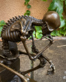 Statue of a pensive skeleton BrokInCZ