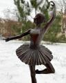 Bronze ballerina in motion statue