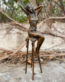 Statue of a girl on bar chair made of bronze