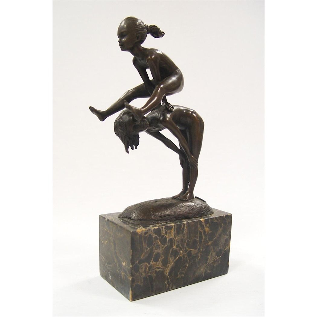Statue Two children playing leapfrog made of bronze
