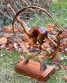 Statue of a gymnast mounted on wooden base made of bronze