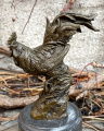 Sculpture of a rooster made of bronze