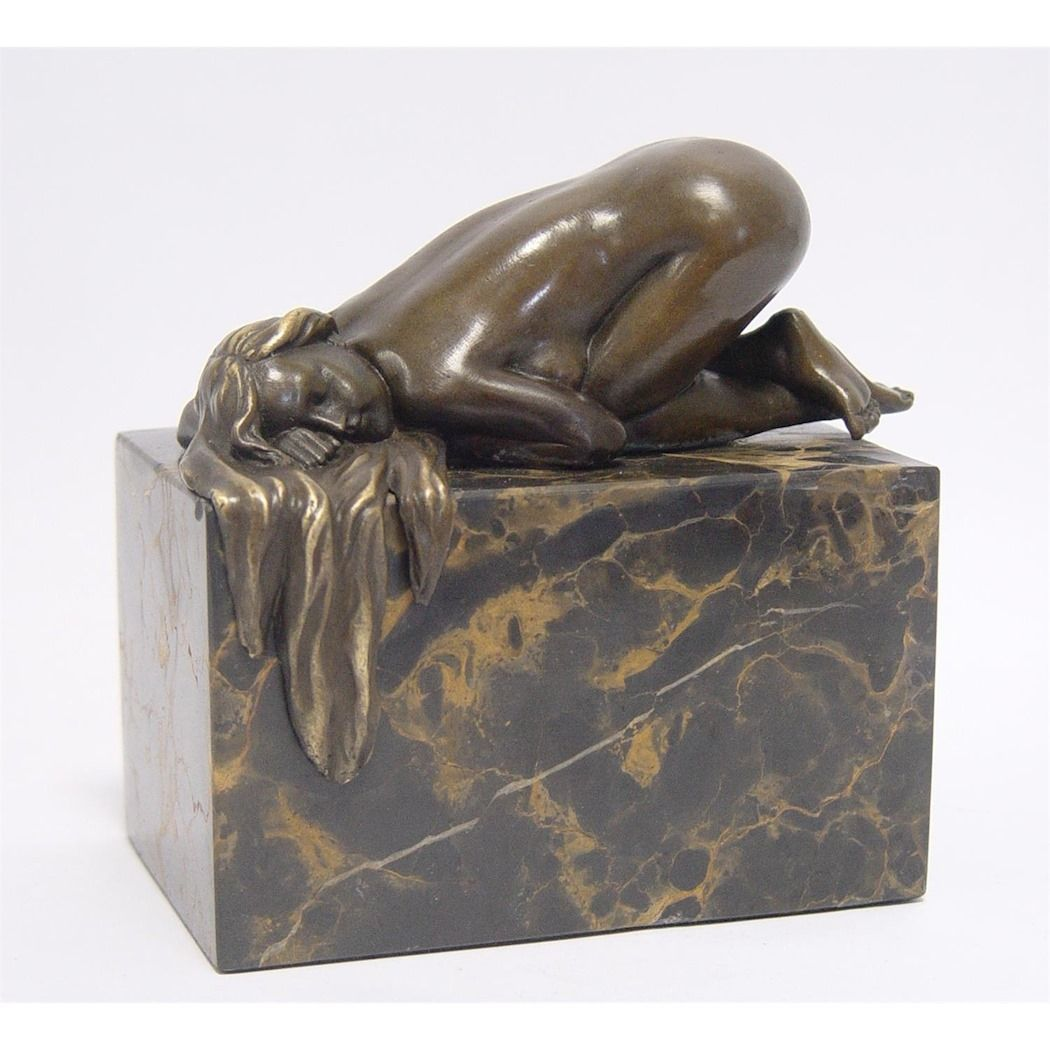 Statue of a nude female made of bronze
