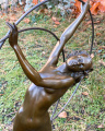 Statue of a dancer with a hoop made of bronze