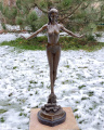 Statue of a woman in bikini made of bronze