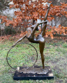 Statue of a gymnast with hoop made of bronze