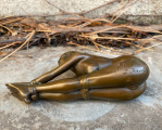 Statue of a tied nude woman made of bronze