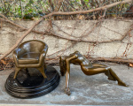 Erotic bronze statuette of a naked sexy woman on a chair