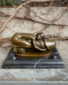 Erotic bronze statuette of a naked woman and a penis