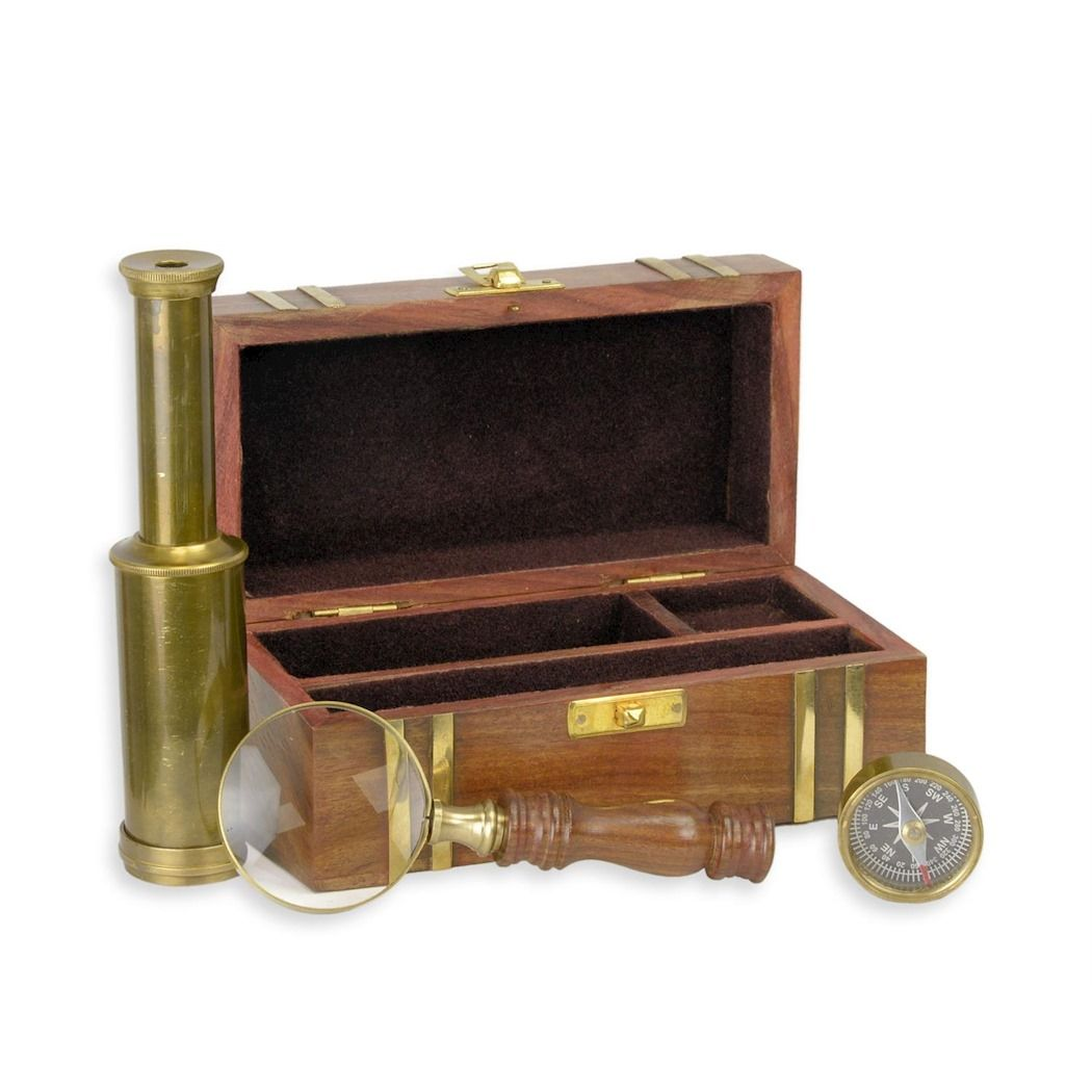 Marine instruments - compass, magnifying glass and binoculars in a wooden case