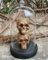 Polyresin figurine of Skulls under a glass dome