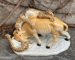Porcelain bull and leopards