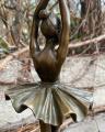 A bronze ballerina sculpture