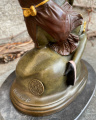 Erotic bronze statuette of a woman and a penis