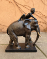 Statuette of a Hindu and elephant made of polyresin